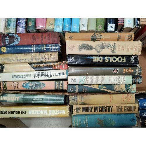 23 - A large selection of 1960's/70's hardback books - thriller spy novels by Frederick Forsyth, etc.; Bo...