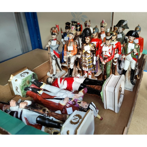 26 - A collection of porcelain military figures...