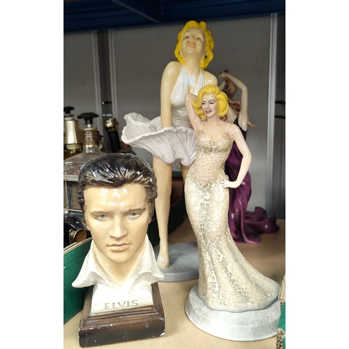 31 - A collection of Marilyn Monroe and other figures...