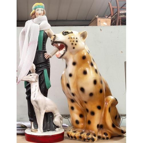 37 - An Art Deco style figure of a 'flapper', 65 cm; a plaster figure of a leopard, 50 cm; a similar lamp...