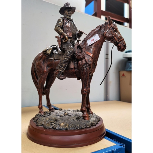 43 - A figure of John Wayne on horseback, and others related...