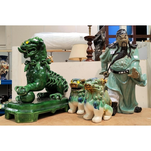 50 - A stoneware figure of a Chinese warrior; a Dog of Fo; etc....