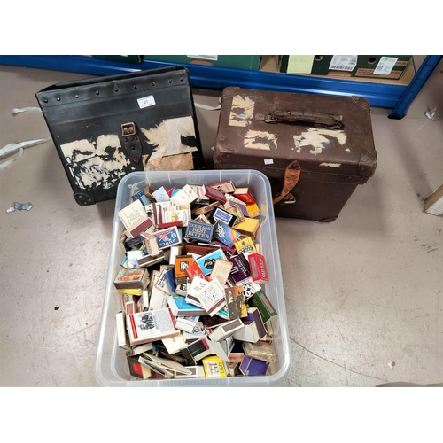 21 - A large collection of matchbooks and packs in vintage hat boxes