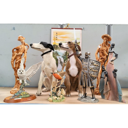 4 - A selection of decorative resin figures:  2 dogs; 2 birds; knight in armour; etc.