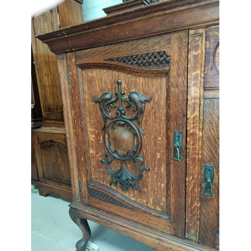 658 - A late 19th century Scottish golden oak mirror back sideboard with extensive carved decoration to th...