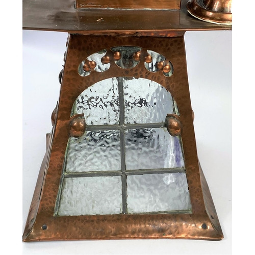 109 - An Arts & Crafts hall lantern in planished copper, square flared form with beaded glass panels (1 a....