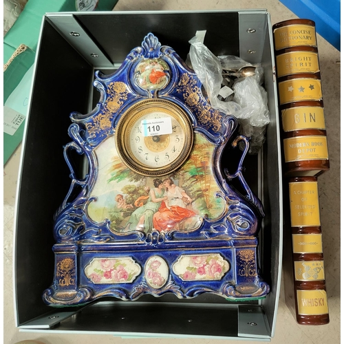 110 - A Victorian china mantel clock; 2 whisky 'books/decanters'; 3 silver teaspoons; a selection of other...