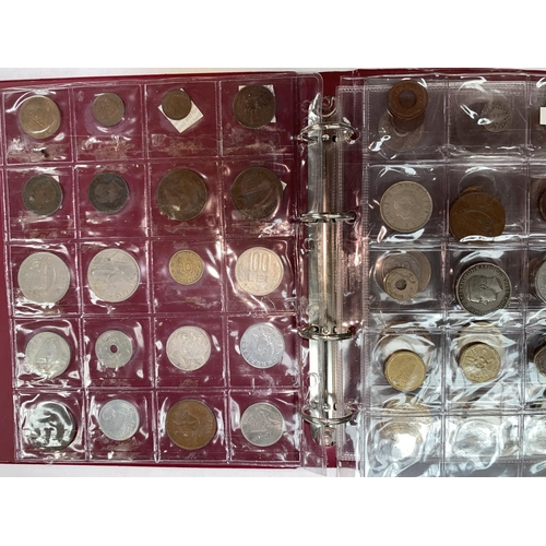 274 - A collection of foreign coins in 2 albums