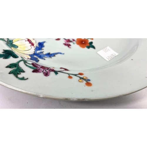 303 - A pair of 18th century Chinese plates with polychrome decoration of flowers, diameter 23cm (minor fr...