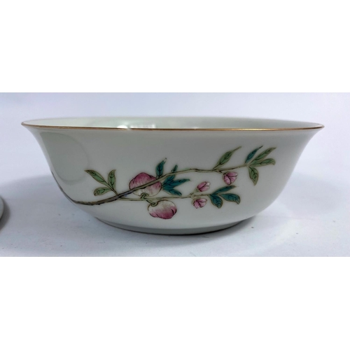 305 - An 18th century Chinese polychrome decorated floral plate, d. 23cm and a later Chinese bowl decorate...