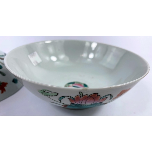 306 - Two 19th century Chinese bowls with floral decoration to exteriors and marks to base, d. 16cm