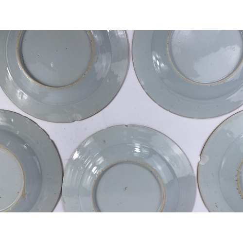 306A - 5 various Chinese blue and white plates decorated with flowers, d. 23cm (plates with chips to rims)