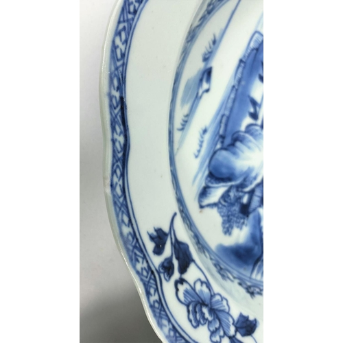 308A - A pair of 18th century Chinese blue and white shallow dishes with traditional mountain scenes, scall...