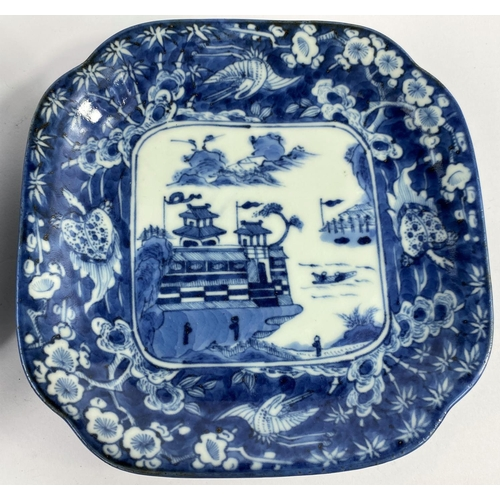 309 - 2 Japanese blue and white squared dishes with central mountain scene and borders with mythical anima...