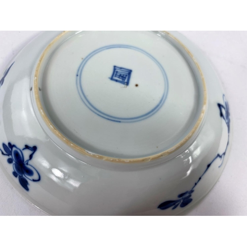 310A - A fine 18th century Chinese porcelain dish with central decoration of vase with flower arrangement, ...