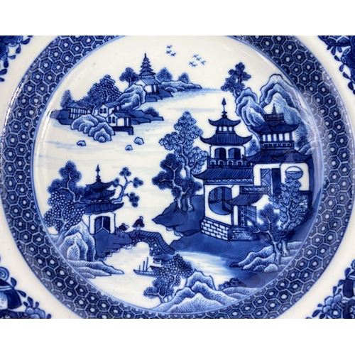 313 - An 18th century Chinese shallow bowl with detailed decoration of traditional mountain scene, with sc...