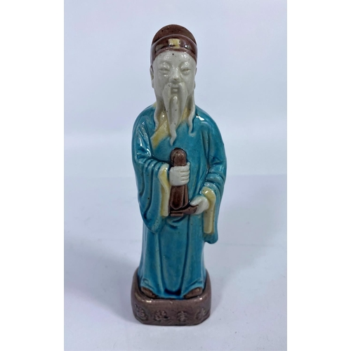 314 - A Chinese ceramic figure of a scholar in blue robes, h. 19cm (Good condition)