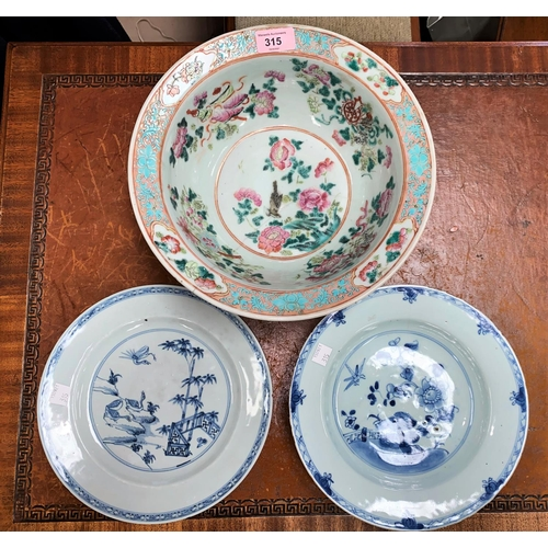 315 - A Chinese famille rose bowl, d. 29cm (restored) and 2 Chinese blue and white plates (Long hairline c...