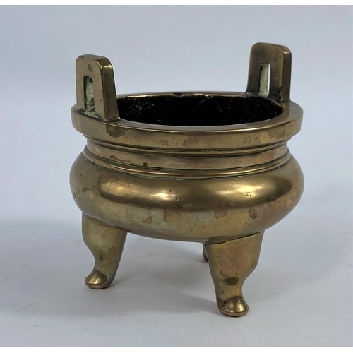 320A - A Chinese polished bronze 3 footed incense burner, d.9cm (a couple of minor dents noted but generall...