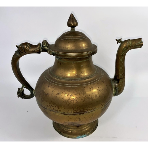 323 - A 19th century Indian large bronze teapot, ht. 27cm (complete with lid, some minor damage to rim of ...