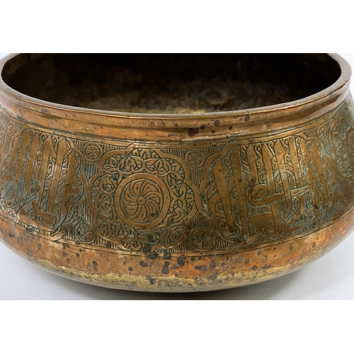 324 - An Indian brass on tin bowl with traditional decoration, d. 27cm (Middle Eastern brass basin with ap...