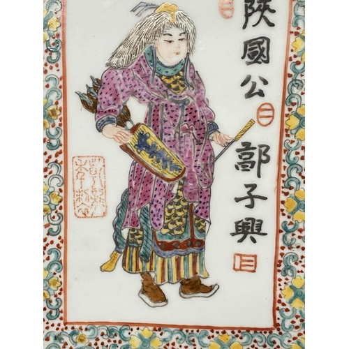 327 - A Chinese porcelain plaque with enamelled inscribed portraits of 4 warriors, 37 x 24 cm, framed