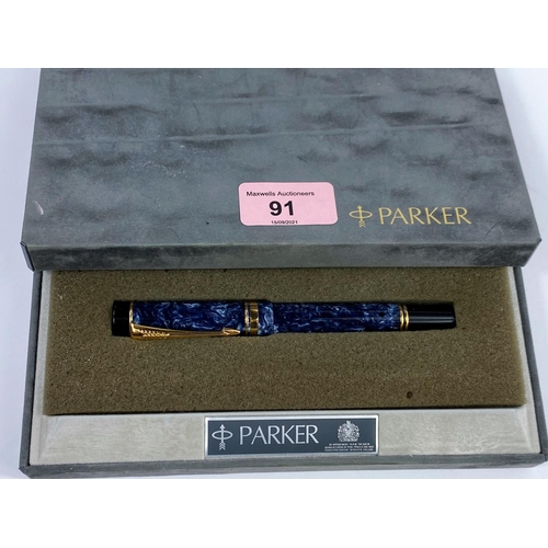 91 - A Parker 'The Duofold' fountain pen with yellow and white metal nib stamped 18ct, with blue marble e...