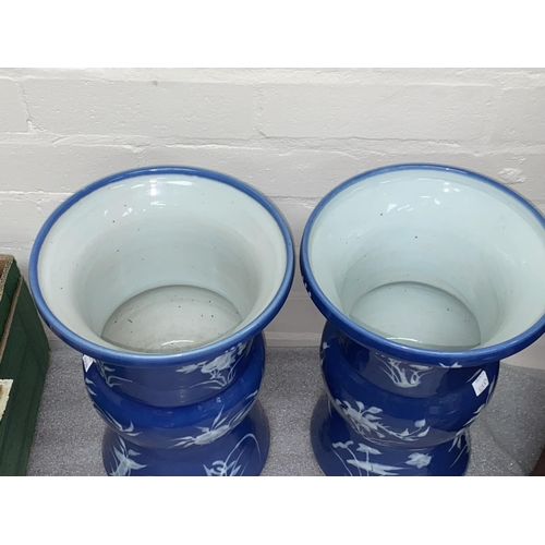 325D - A pair of Chinese 20th century vases with blue glaze and white decoration of plants, ht. 32cm