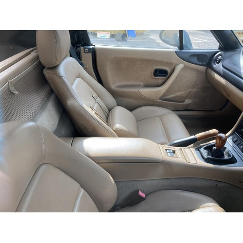 300 - A MAZDA MX-5-SE 2 door sports coupe motor car, green coachwork, cream hood, first registered 13/8/19...