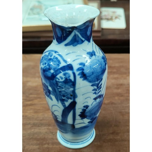 334B - A Chinese blue and white baluster vase, floral and bird decoration, large chip to rim; a continental...