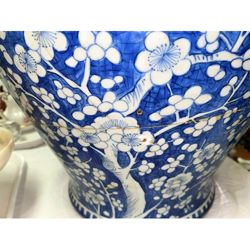 325C - A very large Chinese 18th century blue and white lidded vase with prunus decoration, ht. 52cm (heavi...
