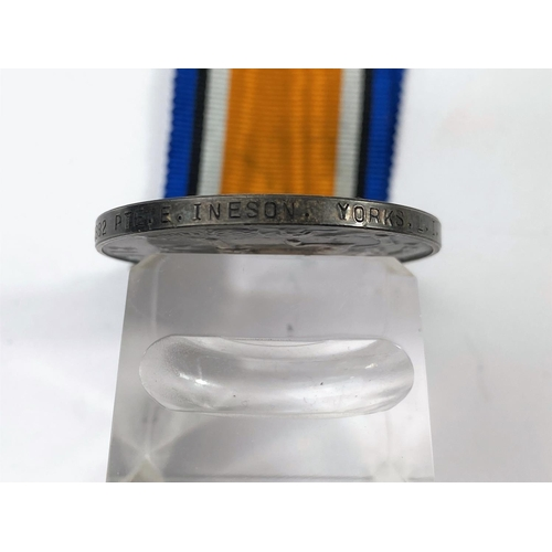 179F - A WWI pair of 1882 pte Ineson Yorks LI; a hallmarked silver Albert with 2 metal medallion inscribed ...