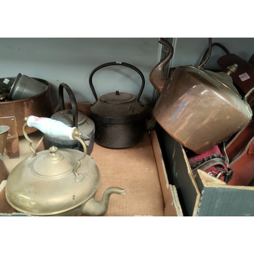 11 - A 19th century copper kettle; a brass and 2 cast iron kettles