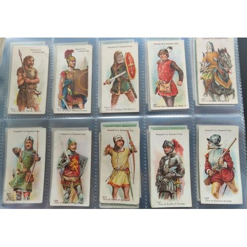 114A - An album of 32 sheets of part sets of cigarette cards, including Ogdens, Faulkner, Hignetts etc.
