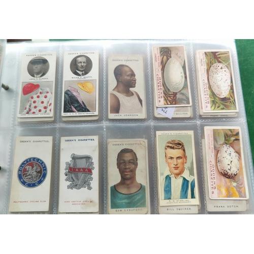 115A - An album of 37 sheets of part sets of cigarette cards including Ogdens etc.