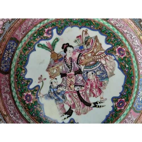 301C - A Chinese porcelain shallow dish with detailed decoration; diameter: 21cm (restored & broken, all pi...