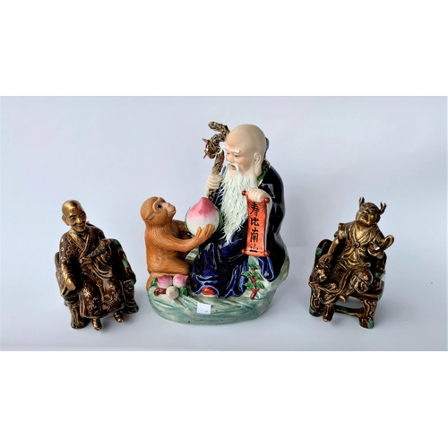 301E - 3 Chinese porcelain figures: one of a monkey giving fruit to a Sage & two others (minor chips and da...