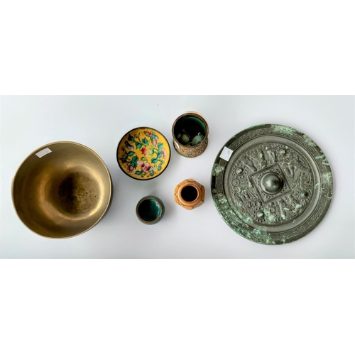 301F - A Chinese bronze mirror and a small selection of metalware