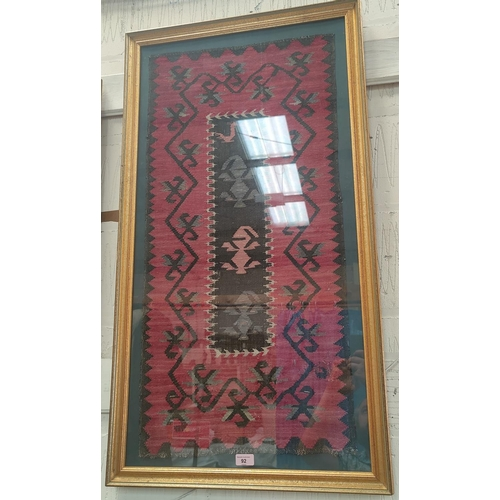 92 - A Kelim rug, late 19th century Anatolia, 45 x 95 cm, framed, Howard Francis Gallery label