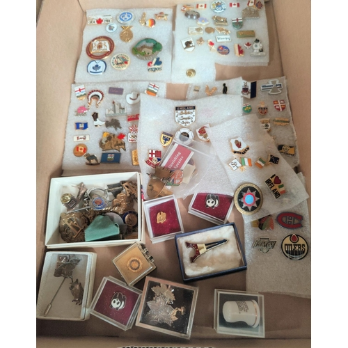 119 - A collection of enamel badges CANADA etc