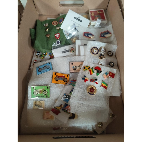 119A - A collction of enamel badges, motorbike stamps etc
