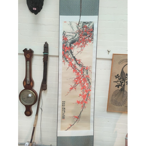 333 - A Chinese woven silk scroll picture depicting a blossom tree, 138 x 39 cm