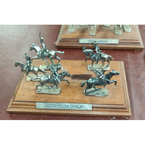 62 - A selection of hall marked silver miniature cavalry and soldiers on wooden plinths, Sheffield 1994; ...