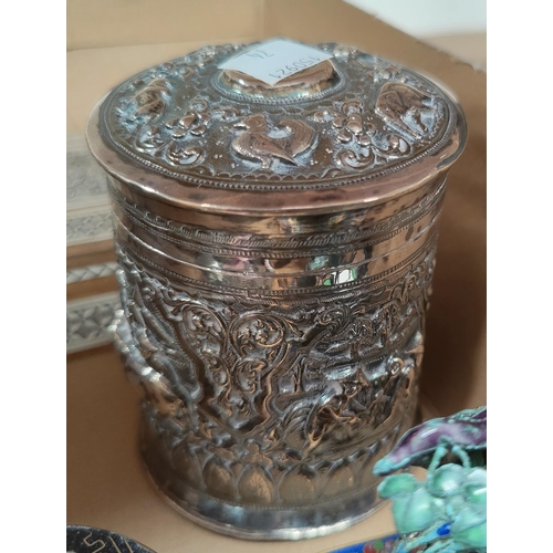 74 - A Sri Lankan covered jar in white metal with extensive relief decoration; 2 pieces of cloisonné; an ...