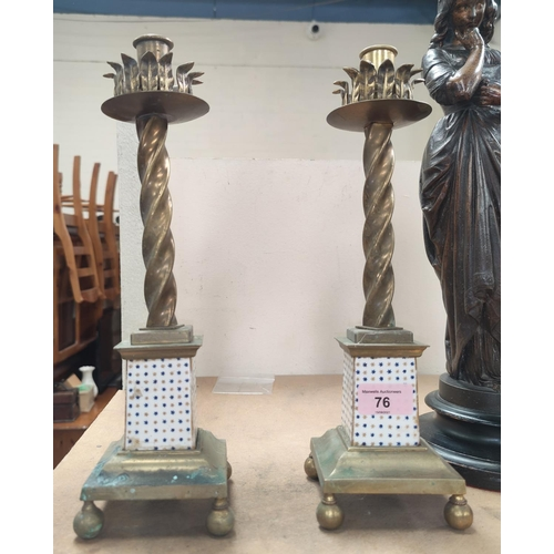 76 - A pair of 19th century rope twst candlesticks with porcelain lower columns, square bases and ball fe...