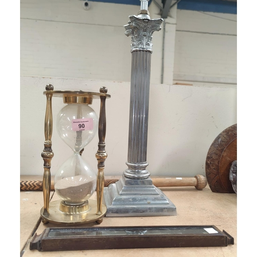 90 - A chromed Corinthian column table lamp; a brass framed hourglass; a thermometer