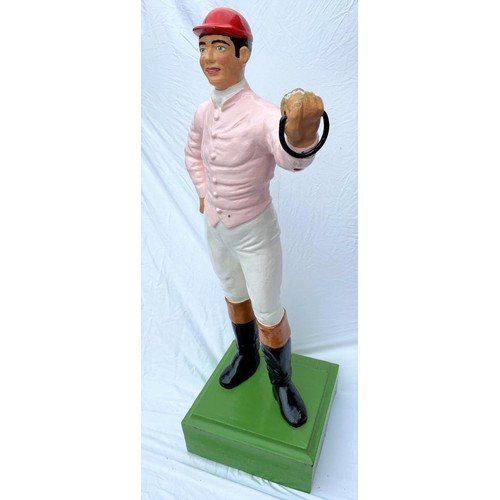 129 - A late 19th / early 20th century cast iron 'hitching post' / Lawn Jockey in the form of a jockey in ...