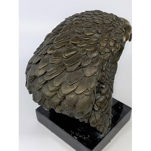 100 - A 20th century animalier style wall hanging bronze, depicting an Eagle's head on a black marble plin...