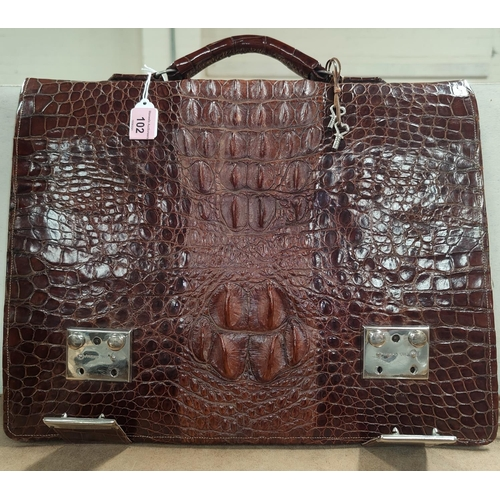 102 - A Crocodile skin attache case with internal compartments and chrome fasteners marked HWA CHENG.  41c...