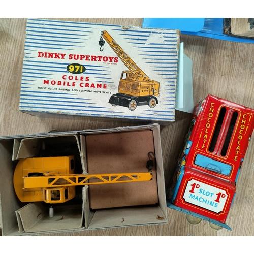 125A - A Dinky Supertoys 971 Coles Mobile Crane, original box; a tinplate 1d slot chocolate dispenser.